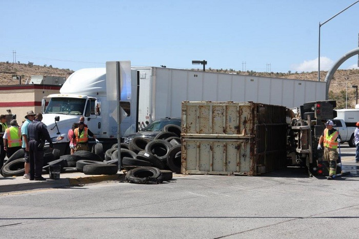 Northwest view Rolled over commercial truck full of tires from September 19, 2018