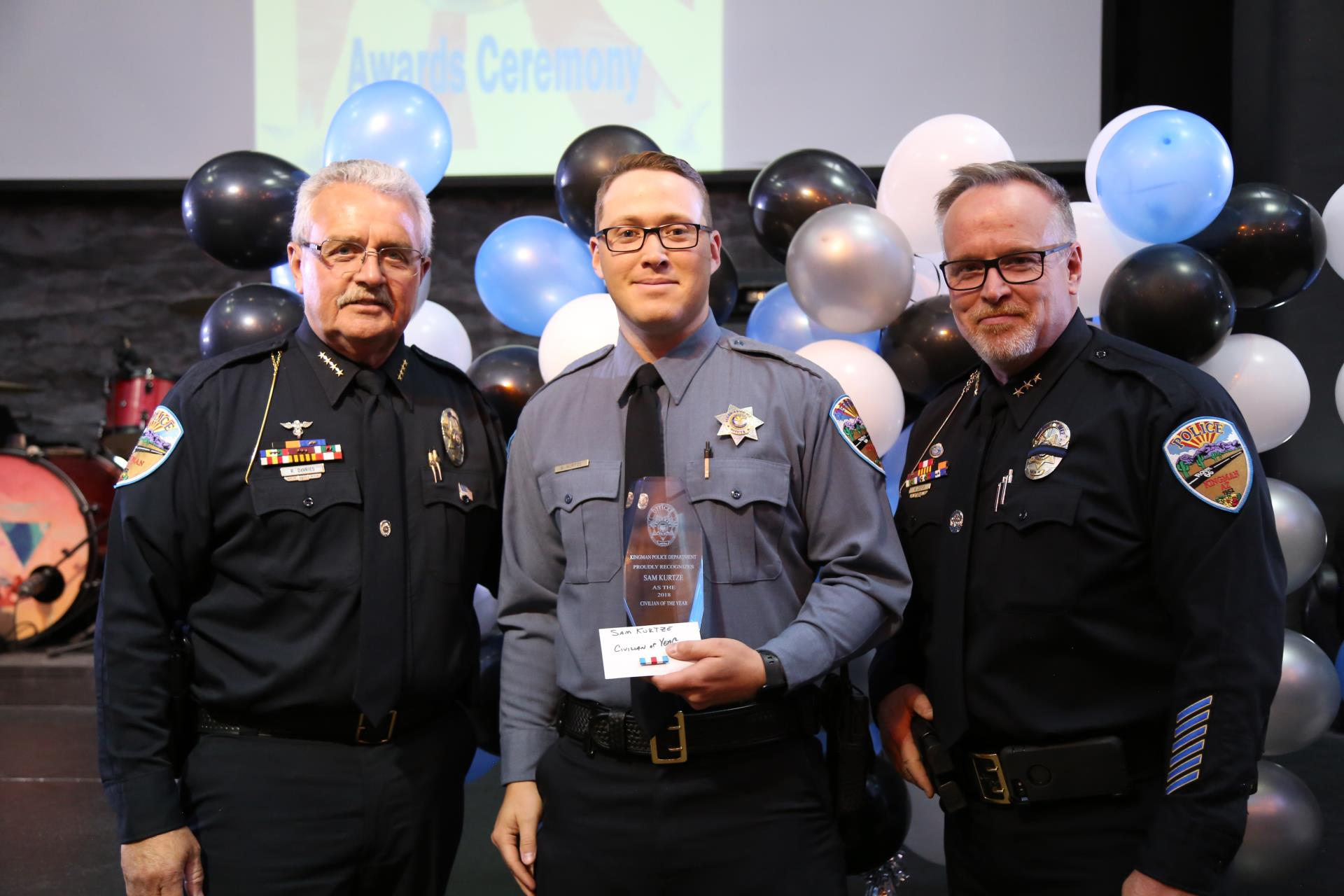 Chief Robert DeVries, Civilian of the Year Sam Kurtze, and Deputy Chief Rusty Cooper