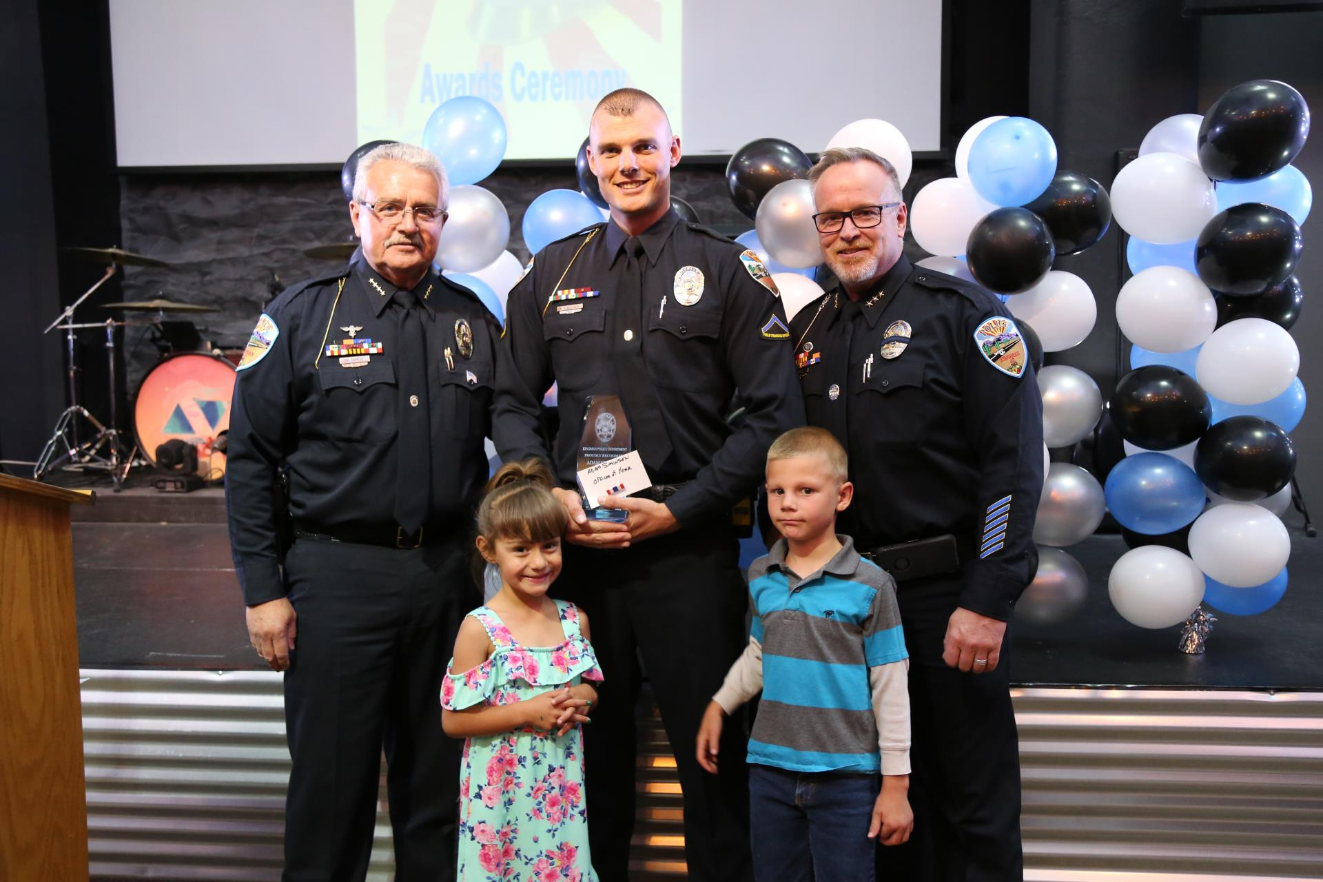 Chief Robert DeVries, Officer of the Year Adam Simonsen and two of his children, and Deputy Chief Rusty Cooper