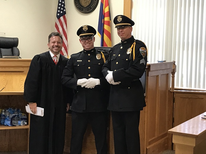 Kingman Municipal Magistrate the Honorable Jeffery Singer, KPD Officer Dennis Miller and KPD Sgt. Danny Reed.