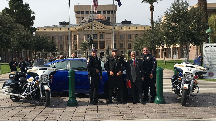 GOHS Dodge Charger grant. Pictured from left to right, standing in front of the new vehicle, are Cpl. Dan Spivey, Ofc. Eric Urquijo, AZ GOHS Director Alberto Gutier and Sgt. David Reif.